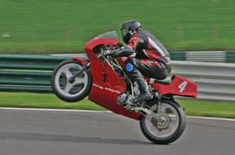 Mike Hose wheelies over the Mountain at Cadwell Park - © Tony Roberts